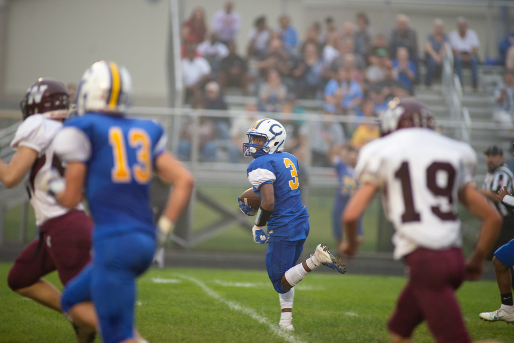 . Aimee Bielozer - The Morning Journal<br> Clearview\'s Joseph Norris looks over his shoulder as he runs back a punt 68 yards for a touchdown against Wellington on Sept. 14.