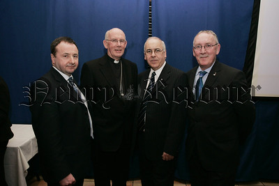 Archbishop Sean Brady and Principal Oliver Mooney pictured with Cllrs Pat McGinn ad John Feehan. 07W5N12