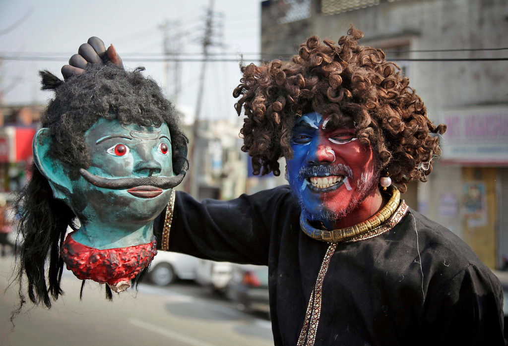 . A Hindu devotee dressed as a demon participates in a procession on the eve of Shivratri festival, in Jammu, India, Wednesday, Feb. 26, 2014.  (AP Photo/Channi Anand)