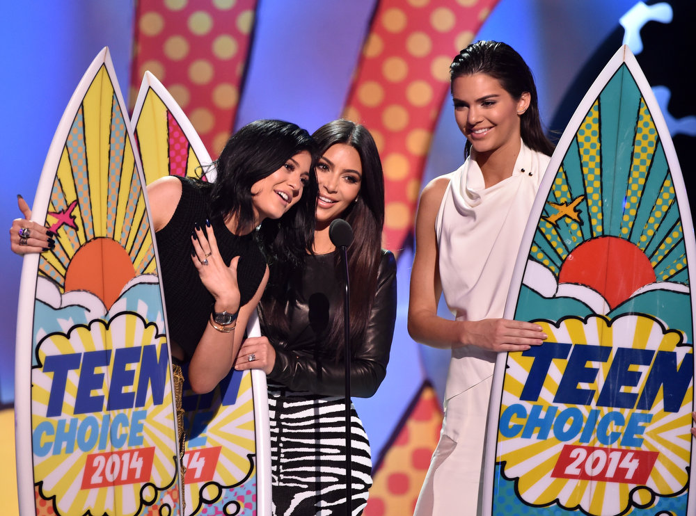 . (L-R) TV personalities Kylie Jenner, Kim Kardashian, and Kendall Jenner onstage during FOX\'s 2014 Teen Choice Awards at The Shrine Auditorium on August 10, 2014 in Los Angeles, California.  (Photo by Kevin Winter/Getty Images)