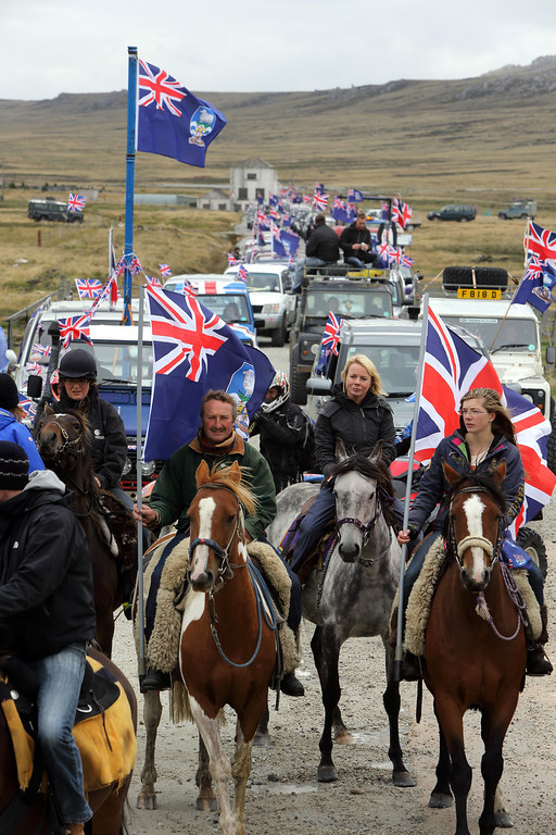 ". Islanders take part in the ""Proud to be British\"" parade along Ross Road in Port Stanley, Falkland (Malvinas for Argentina) Islands, on March 10, 2013.  Falkland Islanders were to vote Monday on the final day of a two-day referendum designed to make clear their staunch desire to remain British despite Argentina\'s increasingly bellicose sovereignty claims. TONY CHATER/AFP/Getty Images"