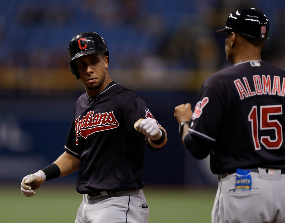 . Cleveland Indians\' Michael Brantley, left, celebrates with first base coach Sandy Alomar Jr. (15) after Brantley singled off Tampa Bay Rays pitcher Vidal Nuno during the eighth inning of a baseball game Tuesday, Sept. 11, 2018, in St. Petersburg, Fla. (AP Photo/Chris O\'Meara)