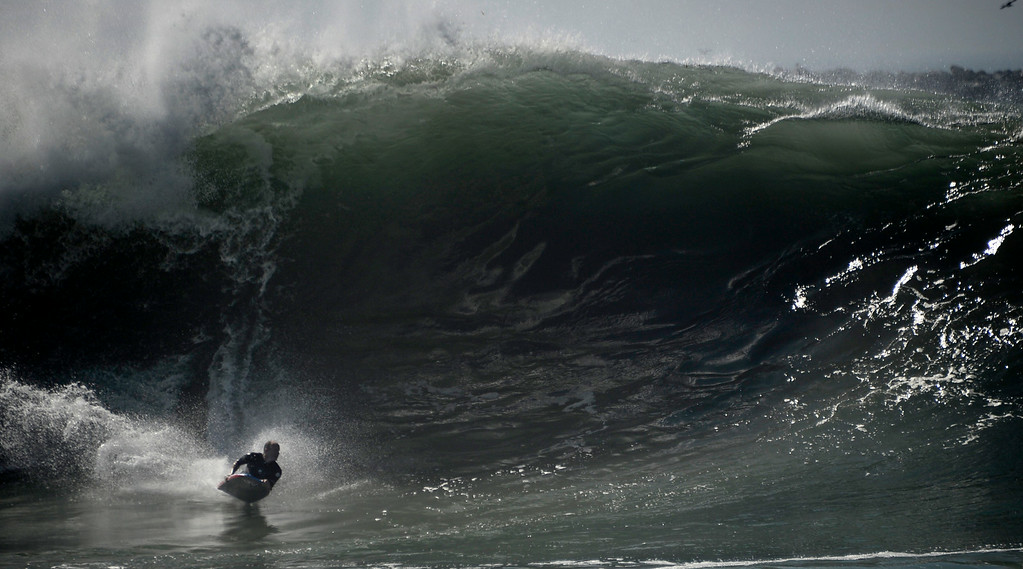 . Aug 27,2014, Newport Beach CA. Surfers go head on a second day with 20-25 foot waves at the Wedge Wednesday morning. The big surf affect is from hurricane Marie down south and is last a few days with big surf hitting the south facing beaches. Photo by Gene Blevins/LA Daily News