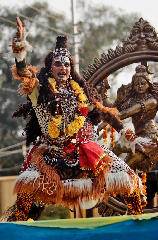 . A devotee dressed as Hindu God Shiva dances as he participates in a procession on the eve of Shivratri festival, in Jammu, India, Wednesday, Feb. 26, 2014. (AP Photo/Channi Anand)