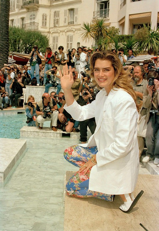 . American actress Brooke Shields waves as she appears in Cannes, France, in front of about 150 photographers during the International Film Festival, May 13, 1990. (AP Photo/Remy de la Mauviniere)