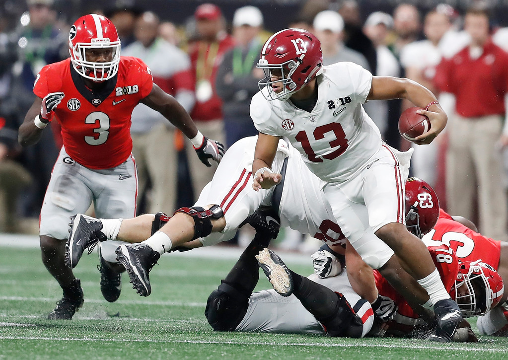 . Alabama quarterback Tua Tagovailoa runs during the second half of the NCAA college football playoff championship game against Georgia, Monday, Jan. 8, 2018, in Atlanta. (AP Photo/David Goldman)