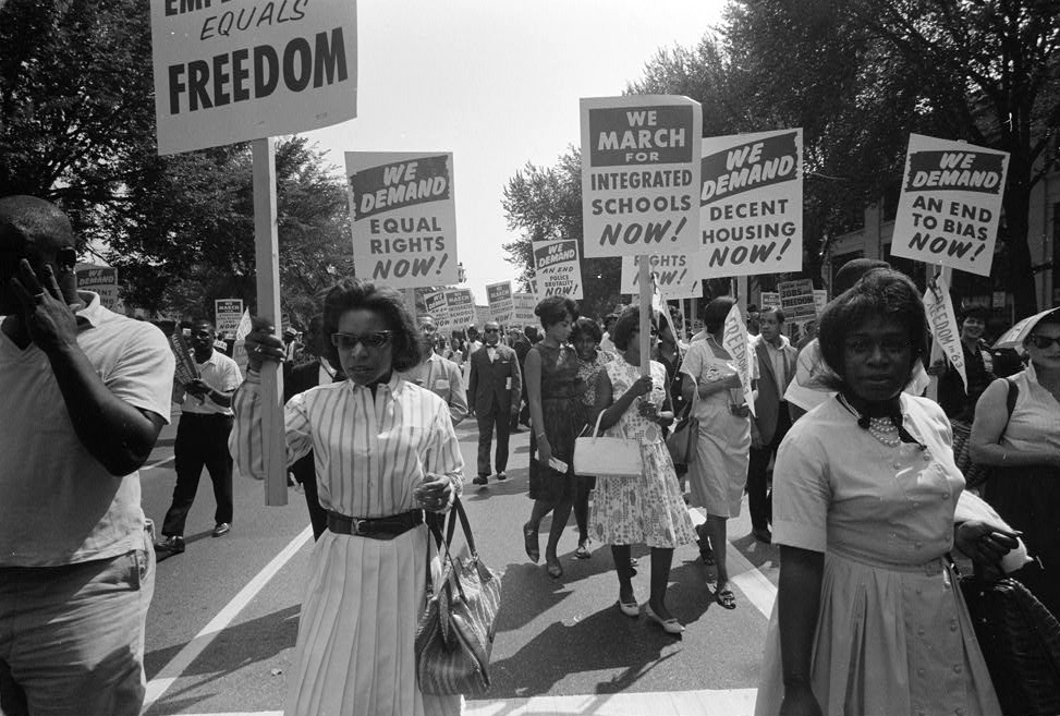 Description of . Civil rights march on Washington, D.C. Demonstrators carry signs for equal rights, integrated schools, decent housing, and an end to bias. Aug. 28, 1963. (Warren K. Leffler - Library of Congress Prints and Photographs Division)