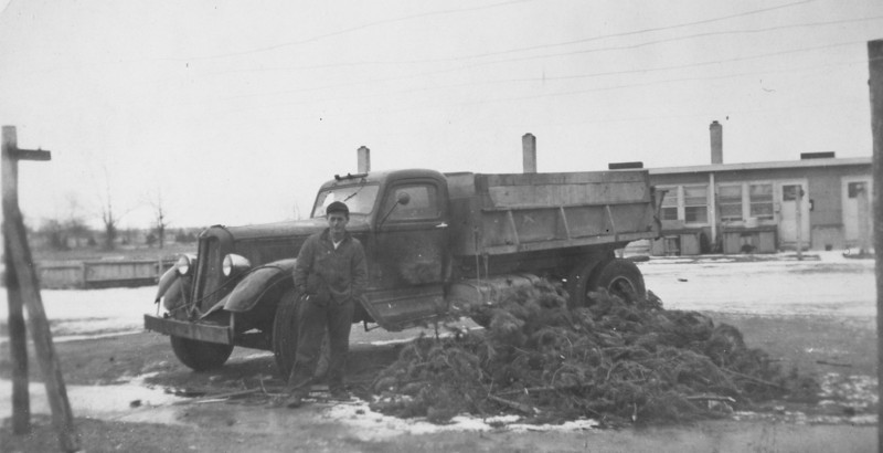 Elmer Ellis Burgin and his dump truck in Cheyenne, Wyoming in the 1940's