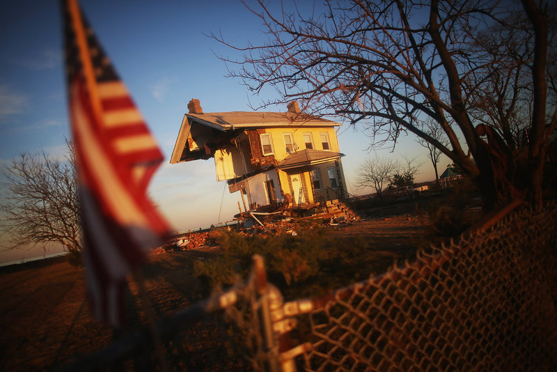 ". The iconic Princess Cottage, built in 1855, remains standing after being ravaged by flooding on November 21, 2012 in Union Beach, New Jersey. Little more than half of the home remains and more than 200 homes were destroyed by Superstorm Sandy in the town. ""Hurricane Sandy\"" was Google\'s number one most searched trending event of 2012. (Photo by Mario Tama/Getty Images)"