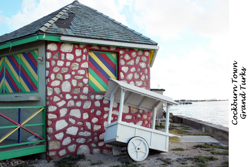 Building and cart along the street vendors in Cockburn Town, Grand Turk