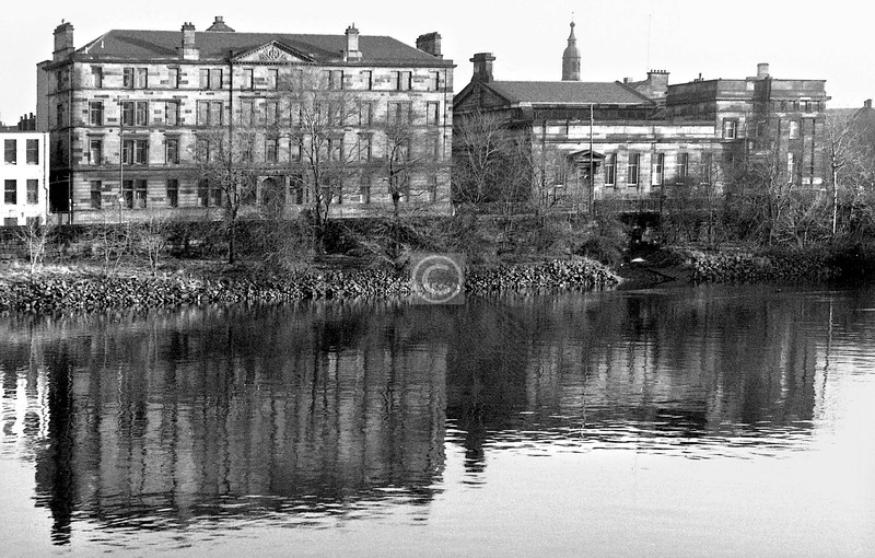 Clyde St east of the railway bridge, from Adelphi St.  Mostly as was. The large block, which was once a police station and barracks, is now a Salvation Army hostel, with an extension replacing the low block on the left.