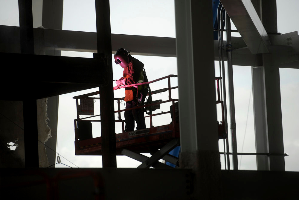 . A worker welds a support at Santa Clara Stadium, the future home of the NFL\'s San Francisco 49\'ers, in Santa Clara, California  March 6, 2013. The stadium is scheduled to open in time for the 2014 NFL season.  REUTERS/Noah Berger