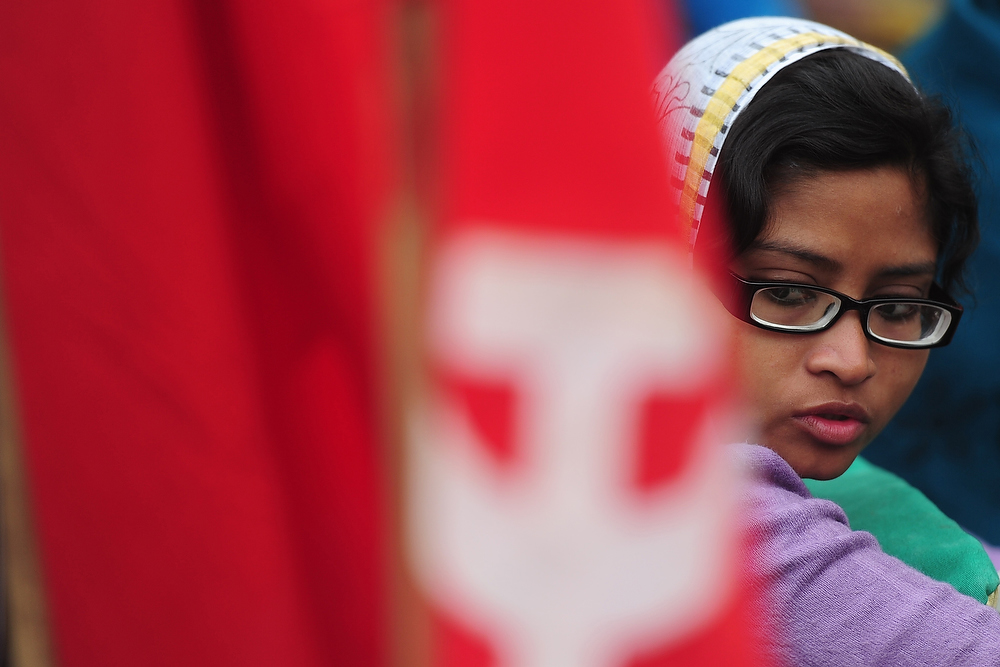 Description of . A Communist Party of Bangladesh (CPB) activist looks on at a rally during a nationwide strike in Dhaka on December 18, 2012. The daylong strike was called by the Communist Party of Bangladesh and Bangladesher Shamajtantrik Dal, demanding a ban on 'all communal political parties' including Jamaat-e-Islami. MUNIR UZ ZAMAN/AFP/Getty Images