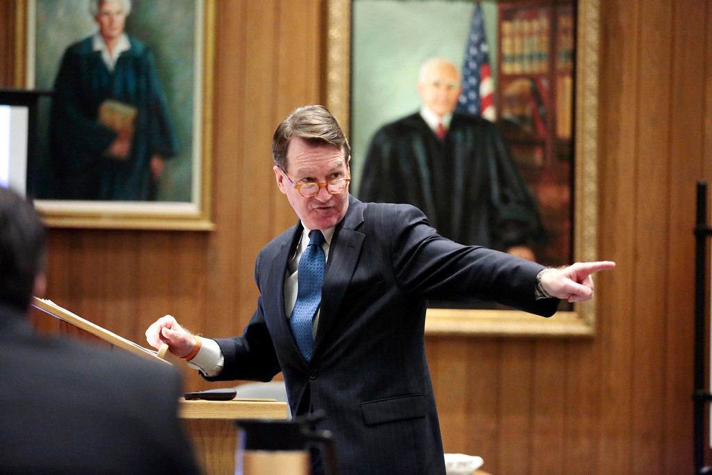 . Berkshire District Attorney David Capeless points to the defendent in his opening statement to the jury during the first day of the triple murder trial for Adam Lee Hall at the Springfield Courthouse. Monday, January 13, 2014. (AP Photo/Stephanie Zollshan, The Berkshire Eagle)