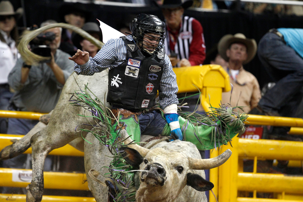 . Jordan Spears of Redding, Calif. competes in bull riding during the first go-round of the Wrangler National Finals Rodeo in Las Vegas Thursday, Dec. 4, 2014. (AP Photo/Las Vegas Sun, Steve Marcus)