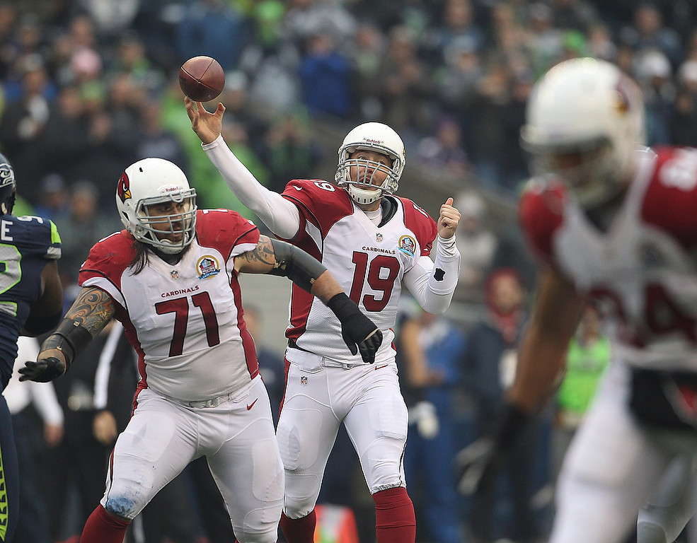 . John Skelton #19 of the Arizona Cardinals throws a pass against the Seattle Seahawks at CenturyLink Field on December 9, 2012 in Seattle, Washington.  (Photo by Kevin Casey/Getty Images)