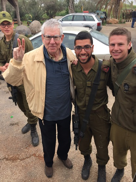 Peter Clapman, '57, originally from Queens, NY at a roadside rest stop somewhere between Jerusalem and Tiberias with two Israeli soldiers, one of whom is a Jewish American also from Queens whose family lives just a block away from Peter's childhood home. - Bridget St. Clair