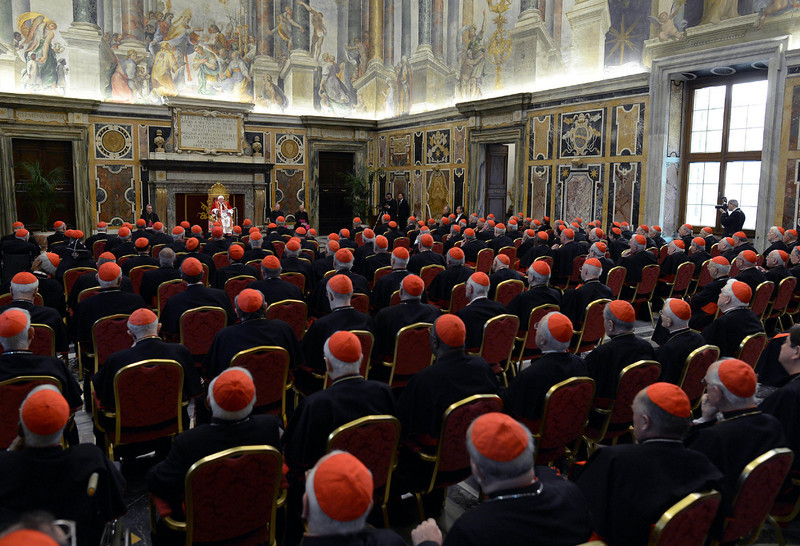 """. In this photo provided by the Vatican newspaper L\'Osservatore Romano, Pope Benedict XVI, top center, delivers his message on the occasion of his farewell meeting to cardinals, at the Vatican, Thursday, Feb. 28, 2013. Benedict XVI promised his \""""unconditional reverence and obedience\"""" to his successor in his final words to his cardinals Thursday, a poignant farewell before he becomes the first pope in 600 years to resign. (AP Photo/L\'Osservatore Romano, ho)"""