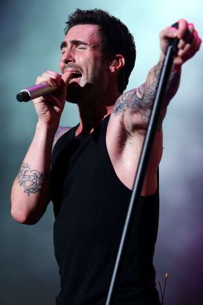 . SINGAPORE - SEPTEMBER 22:  Adam Levine lead singer of Maroon 5 performs during the 2012 F1 Singapore on September 22, 2012 in Singapore.  (Photo by Chris McGrath/Getty Images)