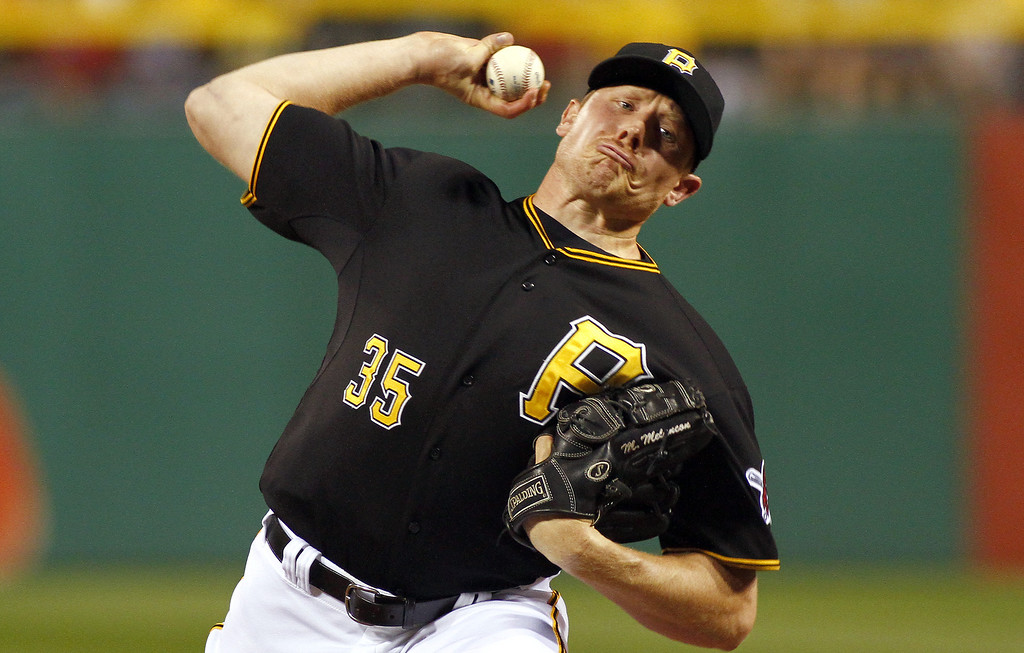 . PITTSBURGH, PA - AUGUST 03:  Mark Melancon #35 of the Pittsburgh Pirates pitches in the ninth inning against the Colorado Rockies during the game on August 3, 2013 at PNC Park in Pittsburgh, Pennsylvania.  (Photo by Justin K. Aller/Getty Images)