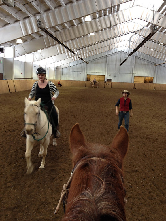 . Amanda Pascoe gets riding instruction from wrangler Annie Bolognino during the horsemanship clinic at Vista Verde in Clark. (Photo by Kyle Wagner)
