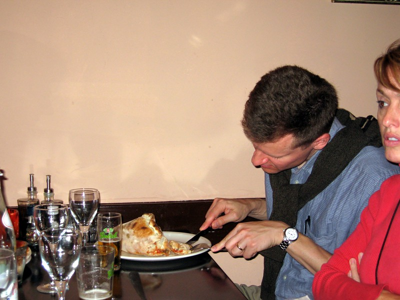 William inspects his monster calzone at a restaurant in The Hague