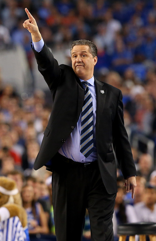 . ARLINGTON, TX - APRIL 07: Head coach John Calipari of the Kentucky Wildcats motions to his players during the NCAA Men\'s Final Four Championship against the Connecticut Huskies at AT&T Stadium on April 7, 2014 in Arlington, Texas.  (Photo by Ronald Martinez/Getty Images)