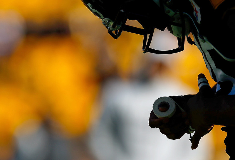 . Ryan Clark #25 of the Pittsburgh Steelers tapes his fingers prior to the game against the Cincinnati Bengals during the game at Heinz Field on December 23, 2012 in Pittsburgh, Pennsylvania. (Photo by Jared Wickerham/Getty Images)