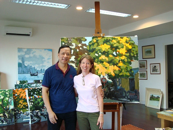With Pham Luan, in his studio high above West Lake in Hanoi, where he finds inspiration for his painting.