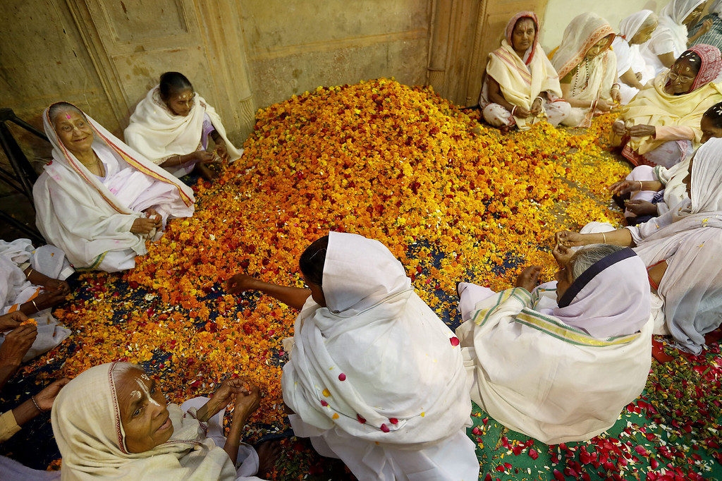 . Indian widows prepare flowers and colours as they participate in the Holi festival in Vrindavan, Uttar Pradesh, India, March 14, 2014.   EPA/HARISH TYAGI