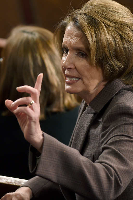 """. House Minority Leader Nancy Pelosi of Calif. talks with her colleagues in the House chamber on Capitol Hill in Washington, Tuesday, March 3, 2015, before Israeli Prime Minister Benjamin Netanyahu addressed a joint meeting of Congress. In a speech that stirred political intrigue in two countries, Netanyahu told Congress that negotiations underway between Iran and the U.S. would \""""all but guarantee\"""" that Tehran will get nuclear weapons, a step that the world must avoid at all costs. (AP Photo/Susan Walsh)"""