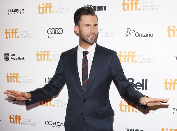 ". TORONTO, ON - SEPTEMBER 07:  Adam Levine arrives at the ""Can A Song Save Your Life?\"" premiere during the 2013 Toronto International Film Festival held at Princess of Wales Theatre on September 7, 2013 in Toronto, Canada.  (Photo by Michael Tran/FilmMagic)"