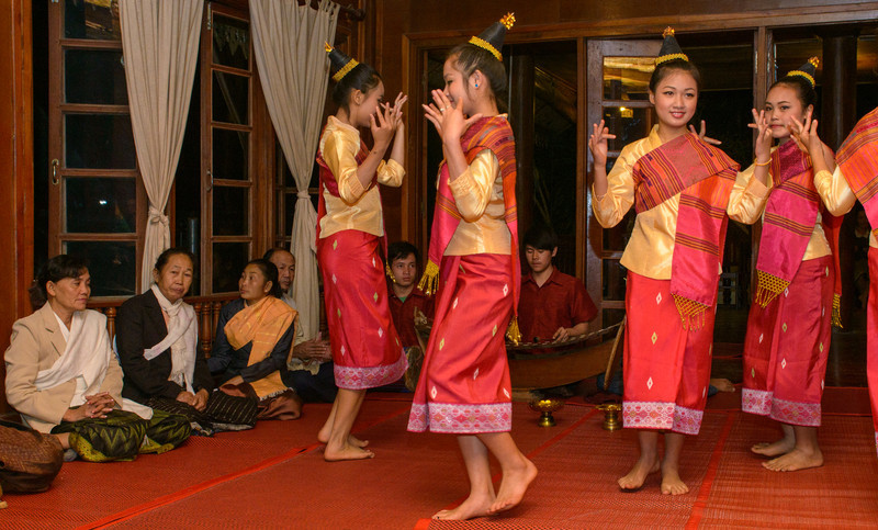 Young women doing Laotian dances in the welcoming ceremony.