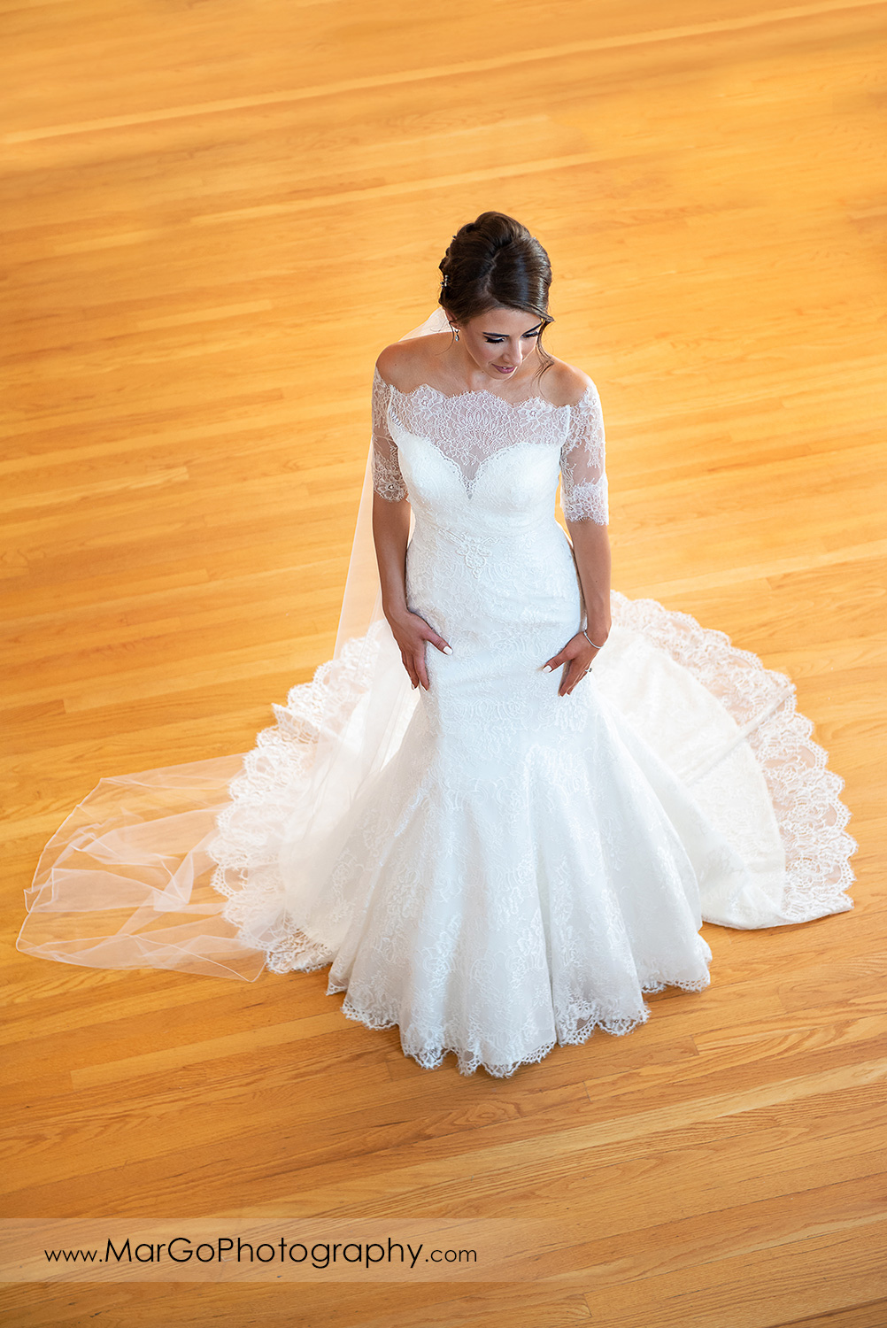 high angle portrait of the bride on wood floor