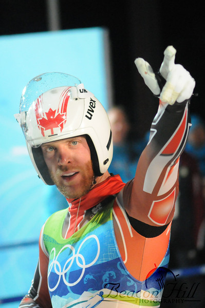 A Canadian luger celebrates his run.