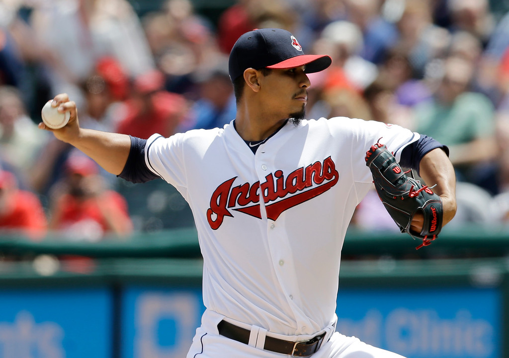 . Cleveland Indians starting pitcher Carlos Carrasco delivers in the first inning of a baseball game against the Detroit Indians, Wednesday, June 24, 2015, in Cleveland. (AP Photo/Tony Dejak)