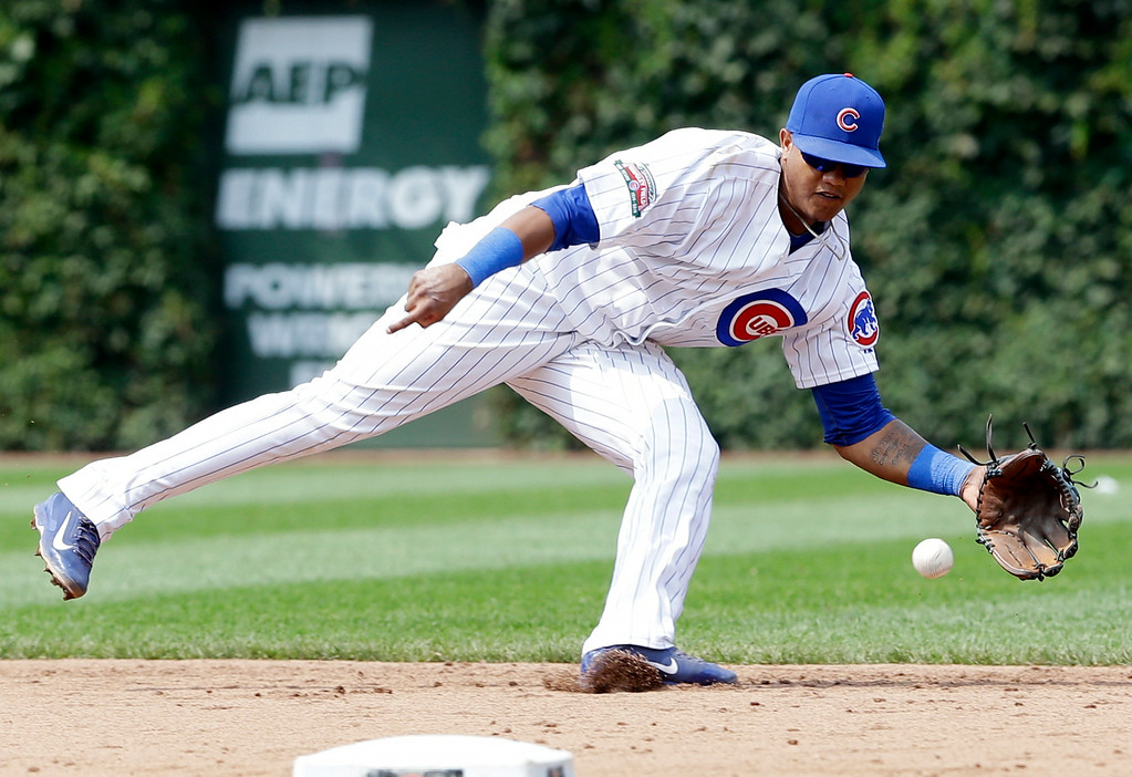 . Chicago Cubs shortstop Starlin Castro catches a ground ball hit by Colorado Rockies\' D.J. LeMahieu during the sixth inning of a baseball game in Chicago, Thursday, July 31, 2014. (AP Photo/Nam Y. Huh)