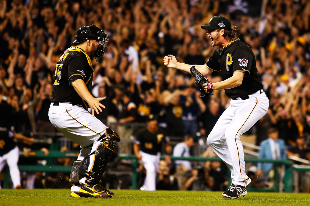 . PITTSBURGH, PA - OCTOBER 01:  Jason Grilli #39 and Russell Martin #55 of the Pittsburgh Pirates celebrate their 6 to 2 win over the Cincinnati Reds during the National League Wild Card game at PNC Park on October 1, 2013 in Pittsburgh, Pennsylvania.  (Photo by Justin K. Aller/Getty Images)