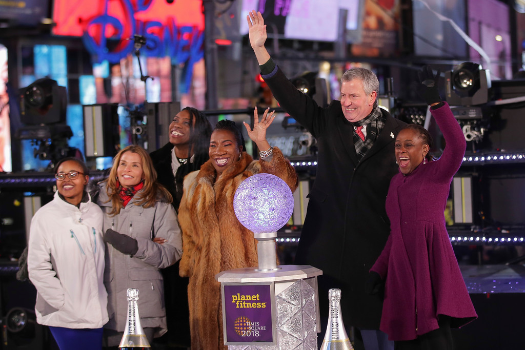 . Activist Tarana Burke, New York City Mayor Bill de Blasio and Chirlane McCray appear on stage at the New Year\'s Eve celebration in Times Square on Sunday, Dec. 31, 2017, in New York. (Photo by Brent N. Clarke/Invision/AP)
