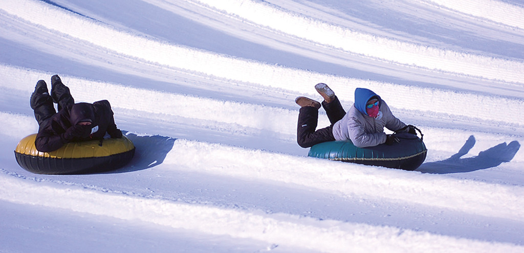 . Two riders go down one of the hills on the tubing hill Wednesday, Dec. 27, 2017, at Sunburst Winter Sports Park in the town of Kewaskum, Wis. Wind chill advisories or warnings are in effect for all of North Dakota and Wisconsin, as well as swaths of South Dakota, Minnesota, Iowa, Michigan and Indiana. (Nicholas Dettmann/West Bend Daily News via AP)