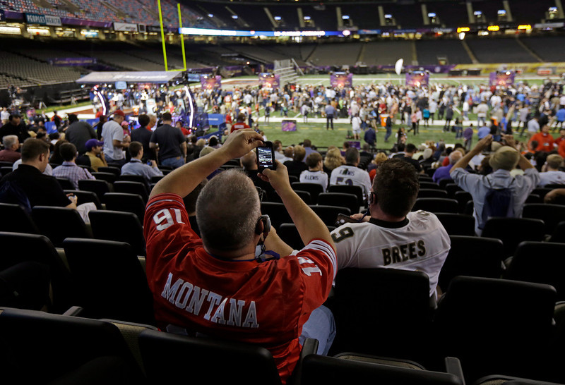 . Fans watch as San Francisco 49ers players participate in media day for the NFL Super Bowl XLVII football game Tuesday, Jan. 29, 2013, in New Orleans. (AP Photo/Gerald Herbert)