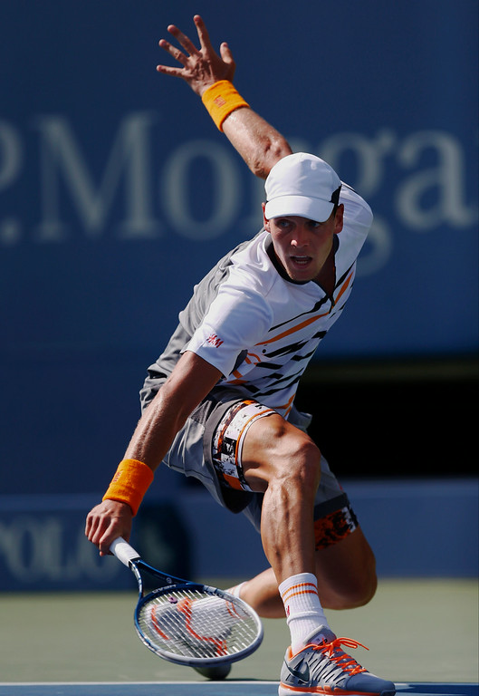 . Tomas Berdych, of the Czech Republic, follows through on a shot against Lleyton Hewitt, of Australia, during the second round of the 2014 U.S. Open tennis tournament, Wednesday, Aug. 27, 2014, in New York. (AP Photo/Matt Rourke)
