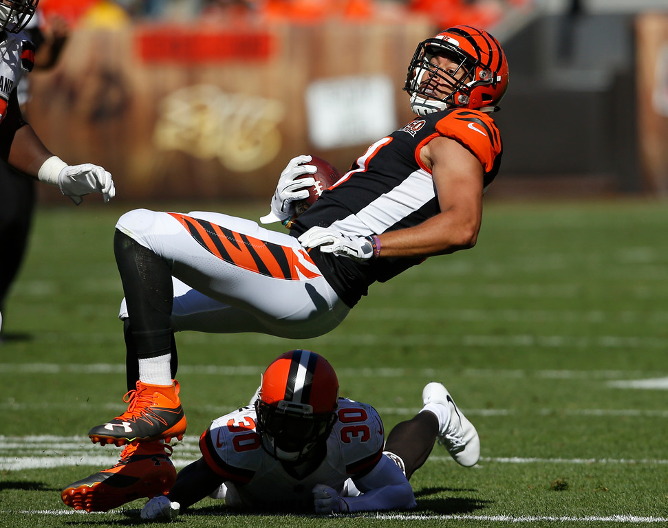 . Cincinnati Bengals tight end C.J. Uzomah, top, is tackled by Cleveland Browns defensive back Jason McCourty (30) in the second half of an NFL football game, Sunday, Oct. 1, 2017, in Cleveland. (AP Photo/Ron Schwane)