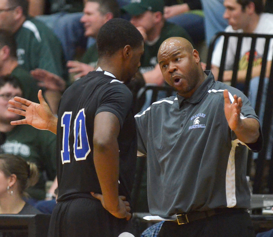 . Jeff Forman/JForman@News-Herald.com Richmond Heights coach jason Priah talks with Dontez Lockett in the fourth quarterof the Spartans\' 59-45 Division IV regional semifinal win over Malvern March 11 at the Canton Field House.
