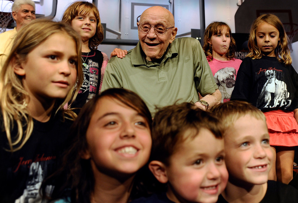 . Jerry Tarkanian, center, a member of the 2013 class of inductees into the Basketball Hall of Fame, poses for a photograph with his grandchildren after a news conference at the hall in Springfield, Mass., Saturday, Sept. 7, 2013. (AP Photo/Jessica Hill)