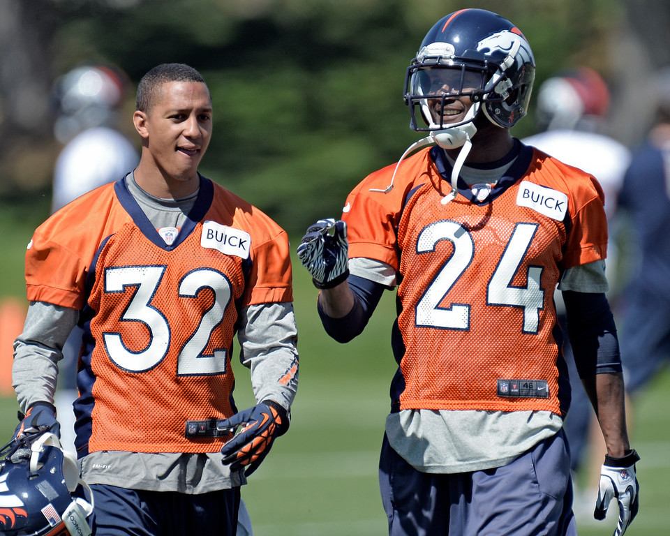 . Champ Bailey (24) of the Denver Broncos talks with Tony Carter (32) CB during OTAs June 3, 2013 at Dove Valley. (Photo By John Leyba/The Denver Post)