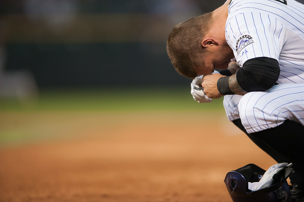 . Brandon Barnes #1 of the Colorado Rockies reacts after flying out with the bases loaded to end the fifth inning of a game against the Pittsburgh Pirates at Coors Field on July 26, 2014 in Denver, Colorado.  (Photo by Dustin Bradford/Getty Images)