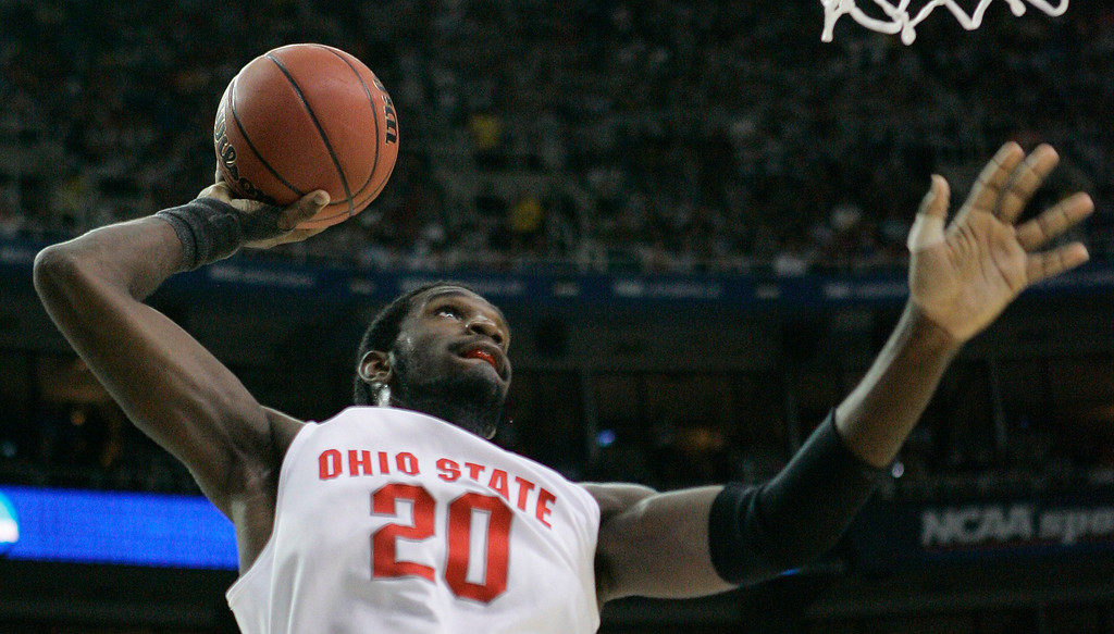 . Ohio State\'s Greg Oden prepares to slam the ball during a 67-60 win over Georgetown in their Final Four semifinal basketball game at the Georgia Dome in Atlanta, Saturday, March 31, 2007. (AP Photo/Gerry Broome)