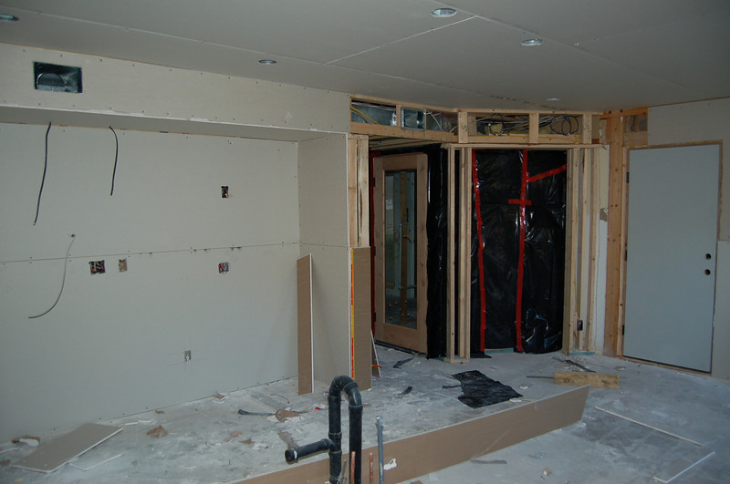 The kitchen, with the wine cellar toward the right (glass door, black plastic with the proverbial red tape).