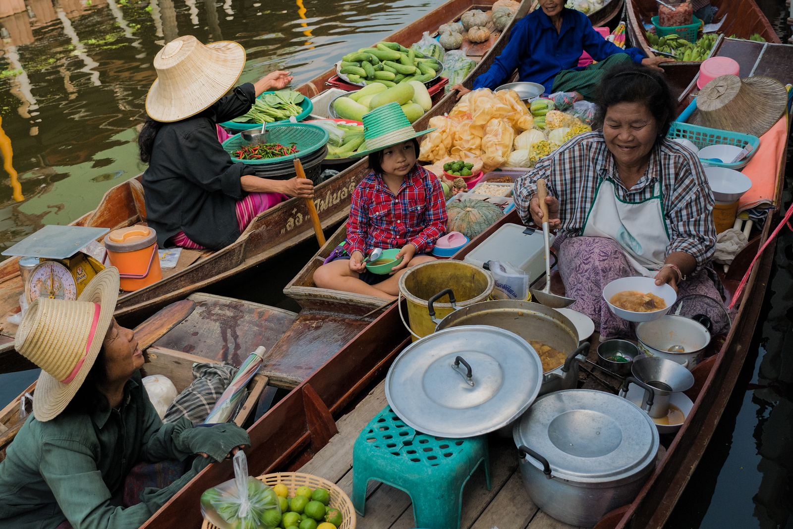 Vendors at the Tha Kha Floating Market in Thailand